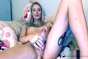Sexy blonde Tgirl jerking big penis