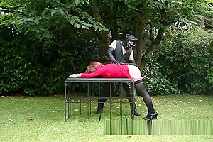 Redhead lady-man whore manacled Spanked And Whipped In The Garden By Leather Clad taskmaster