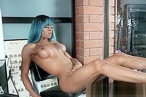 Busty ebony tgirl wanks her big cock