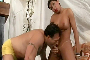 busty brunette shemale drills strong guy