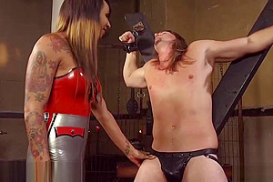 Latex TS domme Seduces Dungeon serf
