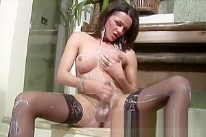 Shemale gets messy with milk and strokes her monster cock