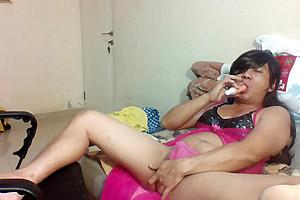indonesian crossdresser in pink lingerie