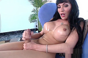 American shemale with massive tits gets a grip on her pole
