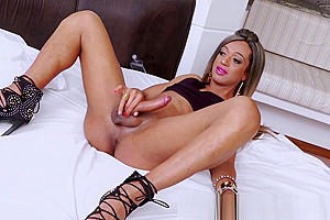 Beautiful shemale babe with a lot of makeup on masturbates