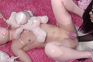 YOUNG PINK LATEX FEMBOY WITH DIRTY GARDENBOY