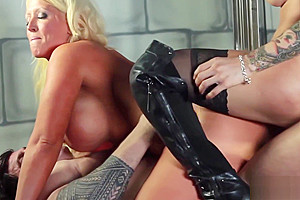 Hardcore threesome with a big titted MILF and hot shemale
