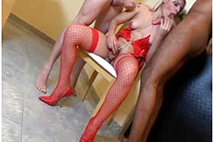 Shemale In Red Lingerie Sucks Two Poles